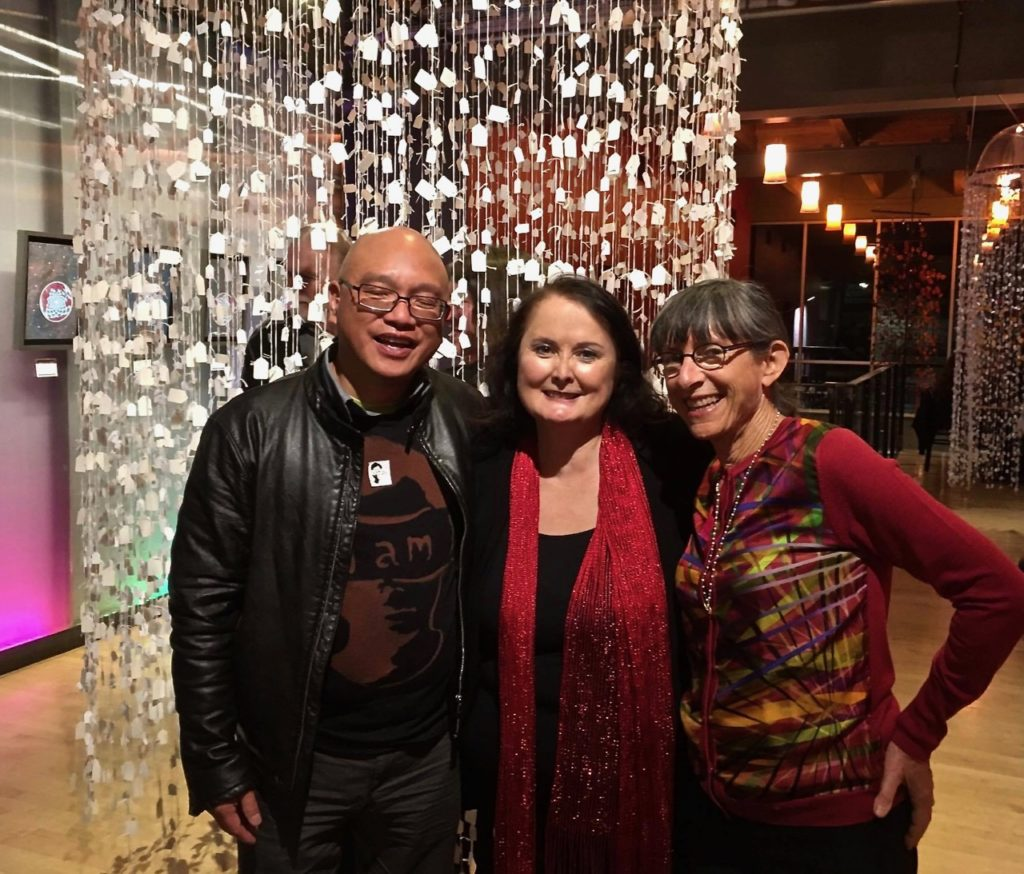 (Dmae pictured with Ronni Lacroute (right) and artist Horatio Law on the opening of Caught at Artists Repertory Theatre)